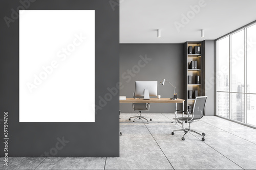 Obraz Modern gray CEO office interior with vertical poster - fototapety do salonu