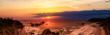 Ecola State Park, Cannon Beach, Oregon, United States. Beautiful Panoramic View Of The Sandy And Rocky Beach On Pacific Ocean Coast. Dramatic Sunset Sky.