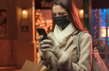 Woman Doing Christmas Shopping And Wearing A Protective Face Mask