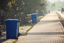 Garbage Cans In Line On The Side Of The Road. Environmental Protection Concept
