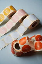Colorful Label Rolls On Blue Background.