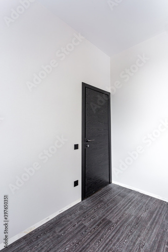 black wooden door in dark style color for modern interior and apartments flat or office Wall mural