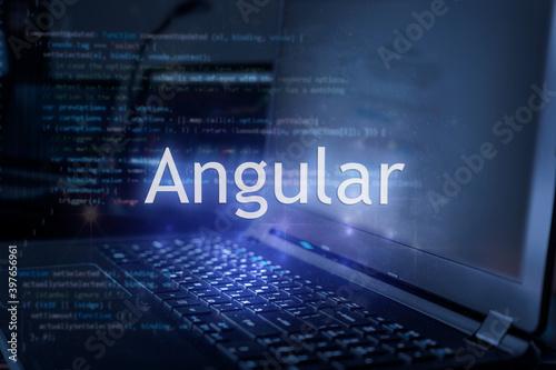 Carta da parati Angular inscription against laptop and code background