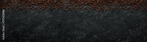 Fototapeta Coffee background. Coffee beans on a black stone background. Top view. Free space for your text. obraz