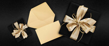 Gift Card, Top View Of Wrapped Present Packages With Golden Ribbon Bow, Envelope And Greeting Card , Isolated On Black Background