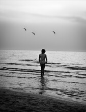 Girl With Seagulls In Shallow Water, Monochrome