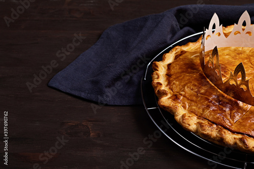 Fototapeta King cake or galette des rois in French. Traditional epiphany pie with golden paper crown obraz