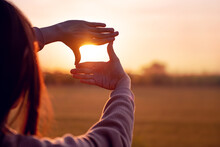 Future Planning Concept, Close Up Of Woman Hands Making Frame Gesture With Sunset, Female Capturing The Sunrise.