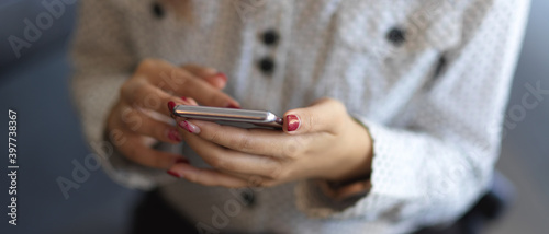 Close up view of female hands texting on smartphone - fototapety na wymiar