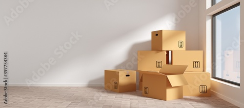 Fototapeta Brown moving storage cardboard boxes stacked in empty room in apartment or house window, moving day concept obraz