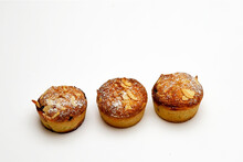 Three Mince Meat Pies With A Frangipane Topping Cover With Almonds And A Dusting Of Icing Sugar