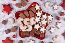 Plate With Traditional German Christmas Sweets Like Cinnamon Star Cookies, 'Baumkuchen' Pralines, 'Dominosteine' And 'Vanillekipferl'