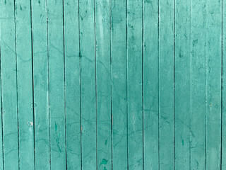 Old green wooden wall made of planks textured background structure
