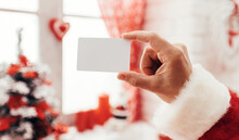 Santa Holding A Business Card