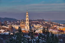 Old Russian City In Winter. City Of Yurievets In Winter. Winter Sleep. Snow-white Bell Tower Of The City. Panorama Of The Old City.