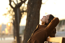 Profile Of A Woman Resting On A Bench In Winter