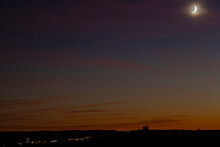 Waxing Crescent Moon In A Beautiful Dusk Landscape During Autumn Season.