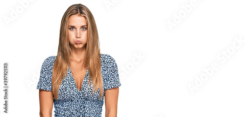 Vászonkép Young blonde woman wearing casual clothes puffing cheeks with funny face
