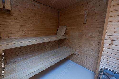 Fototapeta View of sauna room interior. Wooden walls and seats. Health concept. obraz na płótnie
