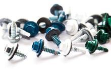 Screws Of Metallic, White, Blue And Green Colors Mixed