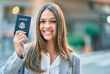 Young Latin Businesswoman Smiling Happy Holding United States Passport At The City.