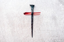 Christian Cross Made With Rusty Nails, Drops Of Blood On Grey Background. Copy Space. Good Friday, Easter Day. Christian Backdrop. Biblical Faith, Gospel, Salvation Concept. Jesus Christ Crucifixion