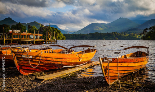 Leinwand Poster Rowing boats on the shore of Derwent water in Keswick,  Lake district,  Cumbria,