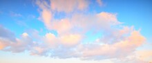 Clear Blue Sky With Glowing Pink Cumulus Clouds After A Blizzard At Sunset. Dramatic Winter Cloudscape. Concept Art, Meteorology, Heaven, Hope, Peace, Graphic Resources, Picturesque Panoramic Scenery