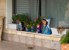 Flower Pots Painted Like Dolls In National Clothes In The Muslim Circassian - Adyghe Village Kfar Kama, Located Not Far From Nazareth In Galilee, In Northern Israel