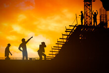 Silhouette Of The Businessman,success Had Been Difficult. On The Surface Above The Sky And The Sun Light,examples Of Success