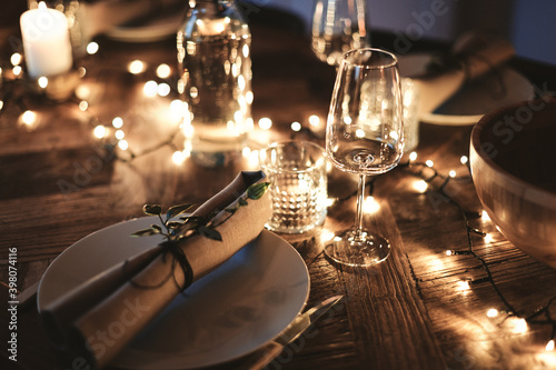 Dining table decorated for an evening dinner party Fotobehang