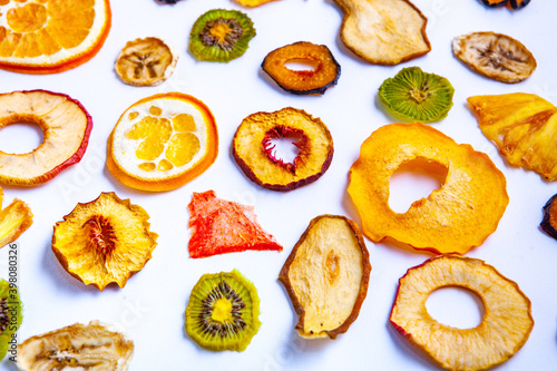 Organic Healthy Assorted Dried Fruit Mix close up. Dried fruit snacks. dried apples, mango, feijoa, dried apricots, prunes top view © romeof