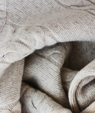 Beautiful Beige Knitted Sweater Close Up View