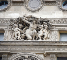 The Louvre.The Facade Of The Flora Pavilion Is Decorated With High Reliefs Of The Triumph Of Flora.The Author Of Them -the French Sculptor Jean-Baptiste Carp