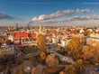 A drone view of the historic city with the market square, churches, town hall and the castle tower in Opole during sunset. Autumn in Silesia - Poland.