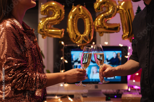 Fotografie, Obraz Celebrating Virtual Christmas New Year's Eve party 2021 at home during Covid-19 pandemic