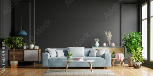 Dark living room,Blue sofa on wooden flooring and black wall.