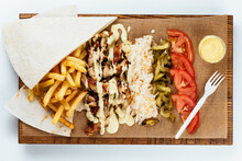 Turkish Shawarma On A Wooden Board And Light Background