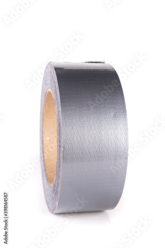 Fotografie, Obraz Large roll of silver shiny reflective duct tape standing up isolated over white
