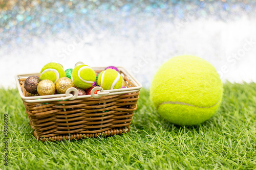 Tennis Easter Holiday with tennis ball are on green grass Fototapeta