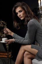 Portrait Of A Beautiful Girl In An Evening Dress With A Cup Of Coffee