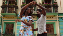 Happy Afro Dancers Curling In Latino Dance In City. Couple Dancing On Street
