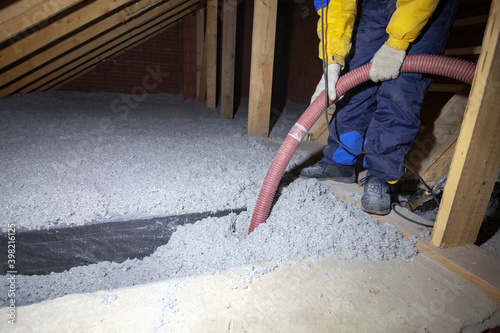Obraz Spraying cellulose insulation in the attic of a house. Insulation of the attic or floor in the house - fototapety do salonu