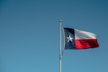 Texas State Flag On Blue Sky