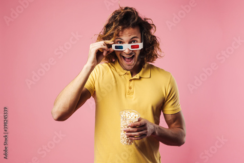 Cheerful young man wearing 3d glasses Wallpaper Mural