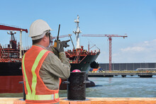 Port Controller, Harbor Master In Command On The Terminal Port For Safety And Control Security During The Operation Of Ship In Shipyard.