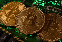 In This Photo Illustration, Bitcoin Cryptocurrency Commemorative Coins On Circuit Board.