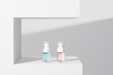 Luxury Cosmetic Bottle Spray And Cream On White Shelf And Bright Background