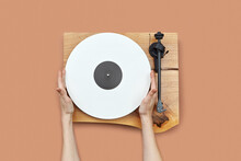 Woman's Hands With Vinyl Record.