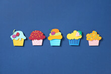 Set Cupcake Paper Cut On Blue Background
